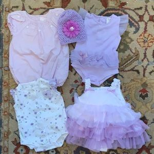 Lot of four lavender 0-3 mo newborn outfits.
